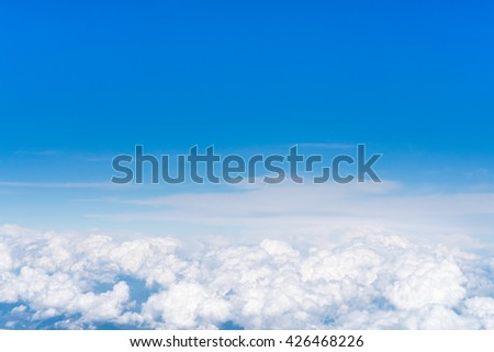 Blue sky above white fluffy cloud, cloudscape background with copy space - stock photo