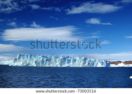 Blue sky and blue icebergs. - stock photo
