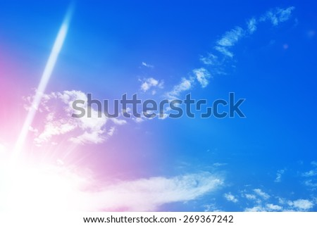 Blue sky and bright sun - stock photo