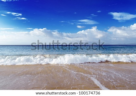 Blue sky and clear water. The White Beach, Puerta Galera, Philippines. - stock photo