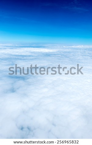 Blue sky and Cloud Top view from airplane window,Nature background. - stock photo