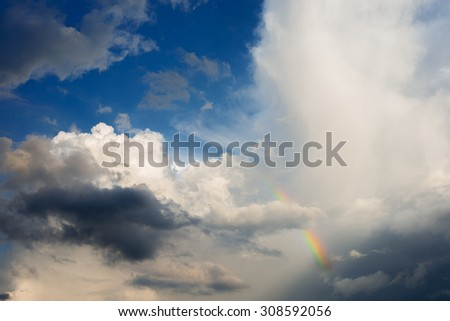 blue sky and cloud with rainbow - stock photo