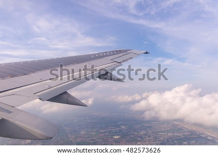 Blue sky and Clouds as seen through window of aircraft.