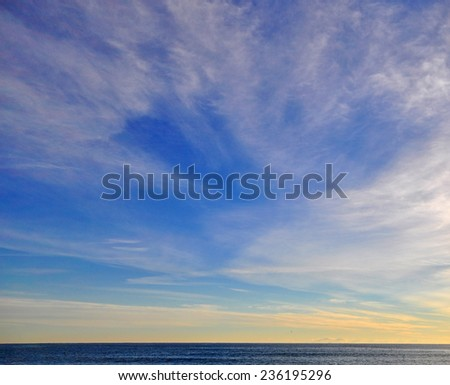 Blue sky and deep sea background - stock photo