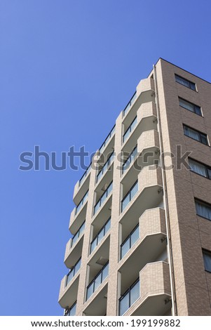 Blue Sky And High-Rise Apartment