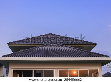Blue sky and home in the evening time - stock photo