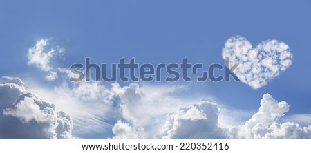 Blue Sky and Love Heart Shaped fluffy clouds   -  Wide Blue Sky Background with various fluffy clouds and one large Love Heart Shaped cloud formation on right hand side - stock photo