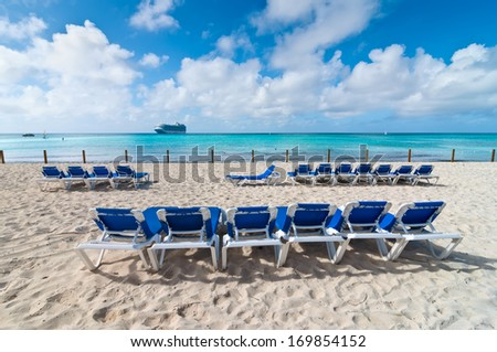 Blue sky and paradise, Tropical island in Bahamas, and a cruise ship on horizon - stock photo