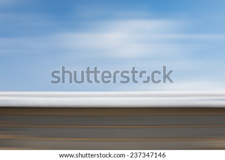 Blue sky and Roof in snow blur motion - stock photo
