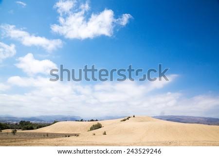 Blue sky and sand dunes. Sunny day. Canary islands, Maspalomas. Spain.  - stock photo