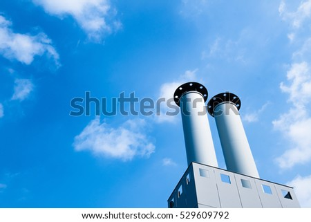 Blue sky and two chimneys