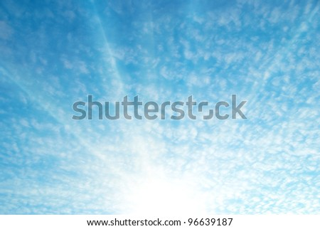 Blue sky and white clouds. Sunrise with sun and sunbeams. - stock photo
