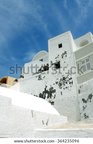 Blue sky and white greek house in Oia town on Santorini Island, Greece. - stock photo
