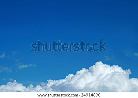 Blue sky and white storm cloud - stock photo