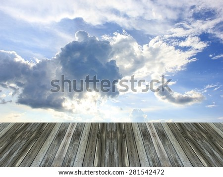 Blue sky and wooden floor background