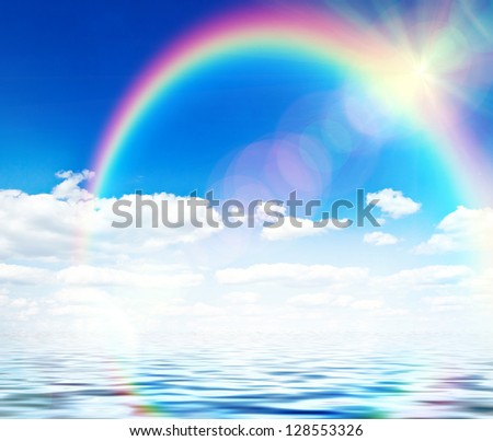 Blue sky background with rainbow and reflection in water - stock photo
