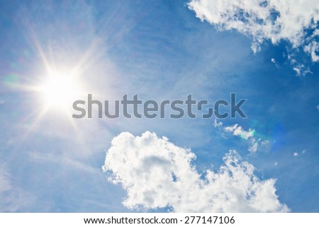 blue sky background with sun - stock photo
