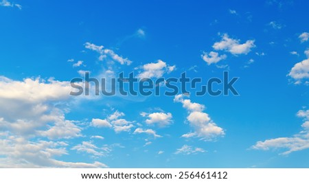 Blue sky background with white clouds on a sunny day. - stock photo