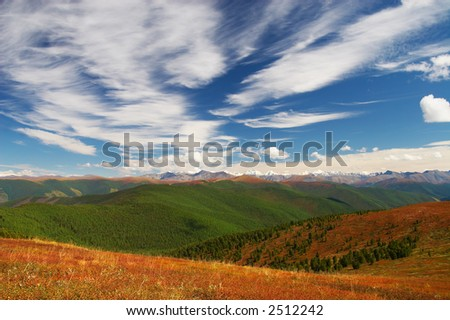 Blue sky, clouds and mountains. Altay. Russia. - stock photo
