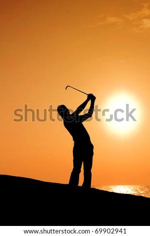 blue sky golfer sunset - stock photo