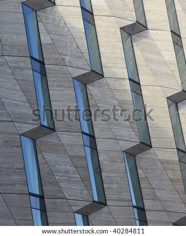 blue sky is Mirrored in a buliding exterior - stock photo