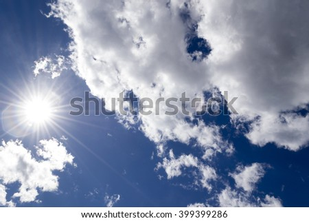 Blue sky. Nature background. Bright sun rays in the sky. Sun shine through clouds. Bright sun rays in the sky. Sun shine through clouds. Deep clean - stock photo