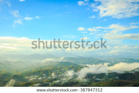 Blue sky on sunrise in the mountains landscape. View point at Ai You Weng, Bethong, Yala, Thailand, Asia. Panorama Light Travel Ecology Ecosystem Earth Time Spring Field Hill Forest Scene concept. - stock photo