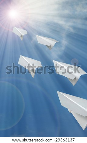 Blue sky on the flying paper airplane - stock photo