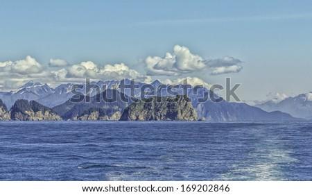 Blue Sky over Mountains near Seward, Alaska, USA - stock photo