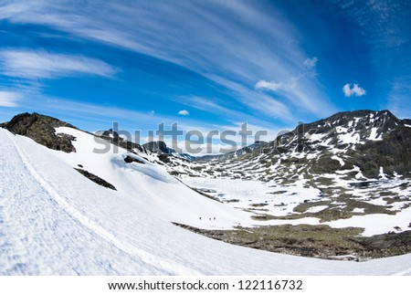 blue sky over snowy hills in Norway - stock photo
