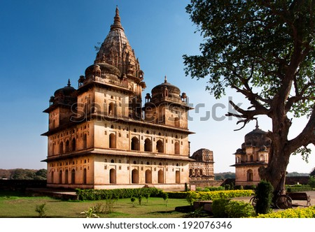 Blue sky over the historical building of the 17th century built like the Memorial to the rulers of Orchha city, Madhya Pradesh state, India.  - stock photo