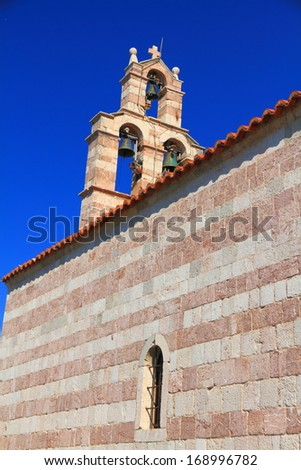 Blue sky over the stone building of orthodox monastery from the Adriatic sea area - stock photo