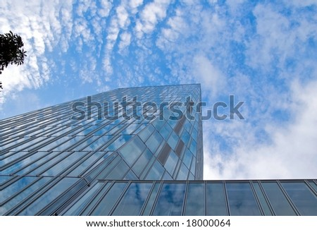 Blue sky reflected in modern glass building