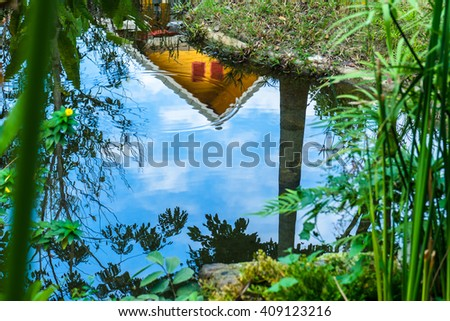 blue sky  reflection on pond in garden