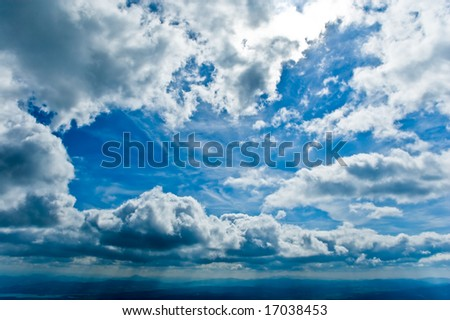 Blue sky, storm clouds and mountains