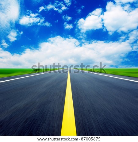 Blue sky, the endless highway. - stock photo
