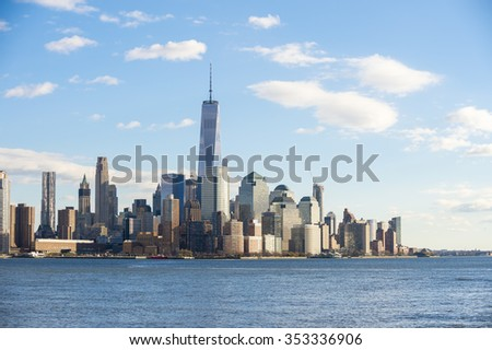 Blue sky view of the Downtown Manhattan skyline from across the Hudson River in New Jersey - stock photo