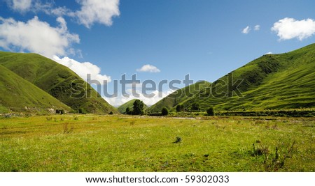 blue sky, white cloud, mountain, grassland. - stock photo