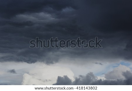 blue sky, white clouds and dark storm clouds - stock photo