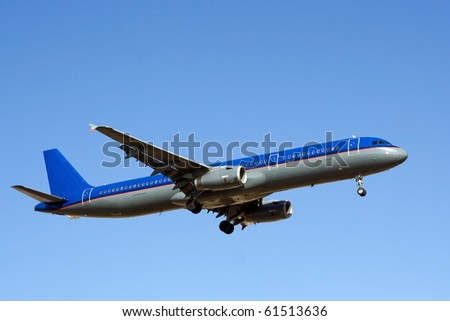 Blue sky with big passenger airplane landing in airport of Palma de Mallorca