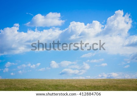 Blue sky with cloud and green meadows in the summer. - stock photo