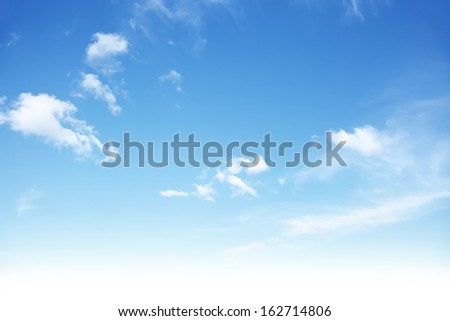 Blue sky with clouds.  - stock photo
