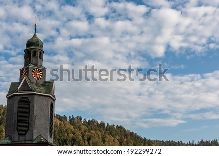 Blue sky with clouds and church tower