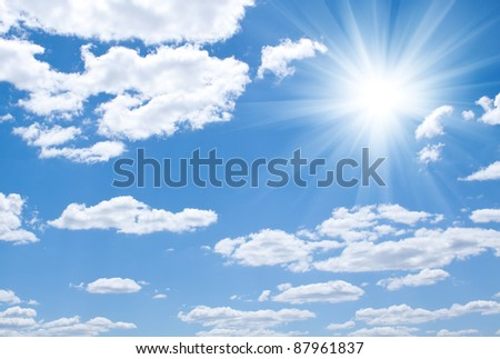 Blue sky with clouds and sun - stock photo
