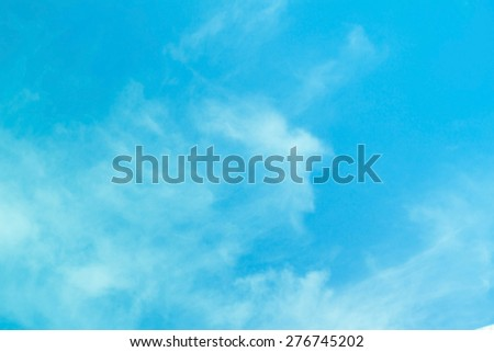 Blue sky with clouds and sun light. - stock photo