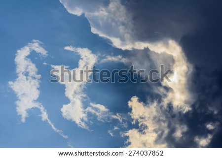 Blue sky with clouds and sun reflection - stock photo