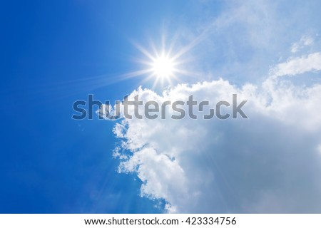 blue sky with clouds and sun reflection. - stock photo