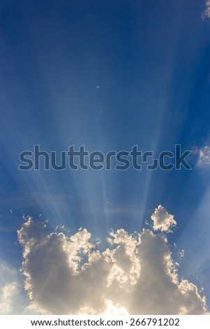 blue sky with clouds and sunbeam - stock photo