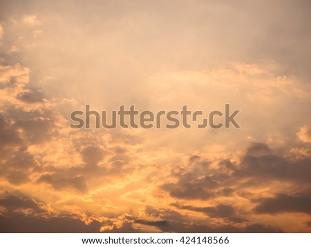 Blue sky with clouds during sunset time - stock photo