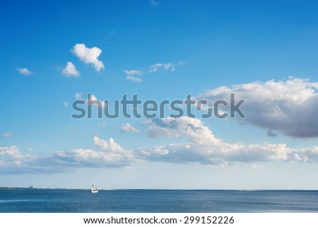 blue sky with clouds over river on sunset - stock photo